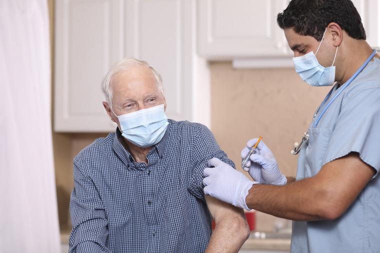 Elderly%20man%20receiving%20flu%20vaccine%20