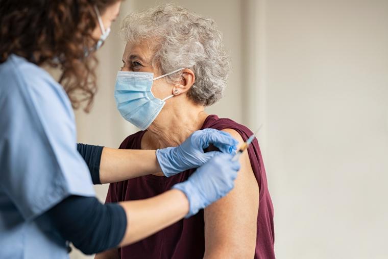 Doctor%20providing%20elderly%20woman%20COVID%20vaccine%20